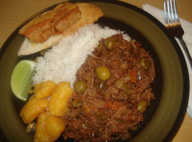 "Authentic Cuban Shredded Beef, ""Ropa Vieja"" Cubana. This looks so good. Guy P had this on Diner Dives and Drive ins"