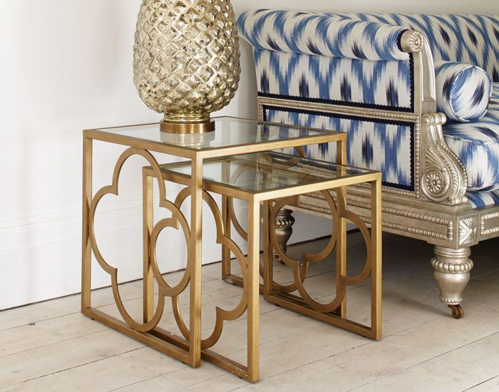 Ava Nest of Tables, Julian Chichester.  Set of two nesting tables with a warm aged gold quatrefoil frame and clear glass insert