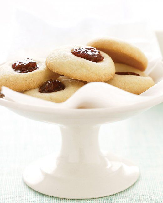Jam thumbprint cookies made with blackberry jam, like Aunt Maggie's Jam Thumbprint Cookies from Martha Stewart, are a kid-friendly dessert using the traditional Michaelmas treat of blackberries--just be sure to use seedless or strained jam!