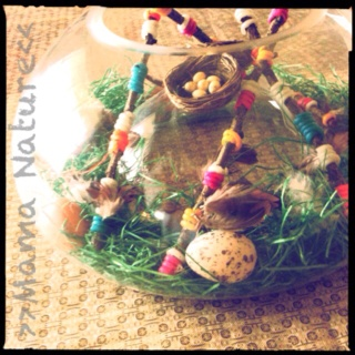 This is such a fun activities for children! It makes a great Ostara or Easter centerpiece!  Basically the kids create a nest using nature (feathers, grass, eggs and sticks) ask me how we created the sticks! It's an original idea-that I haven't leaked out to pinterest yet ;) AND we are using the sticks to create a summer solstice mobile!