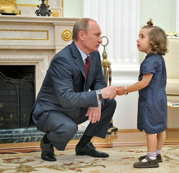 I Love this photograph of President Vladimir Putin shaking hands and speaking to this beautiful little russian girl