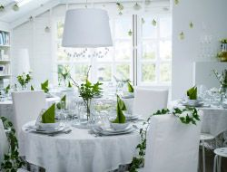 Wedding party in white and green decorations and tableware