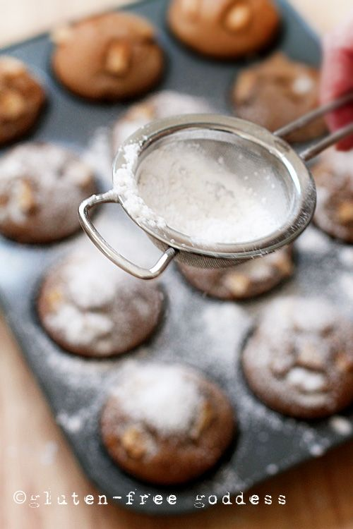 Sifting powdered sugar on apple cake muffins- these babies are gluten and dairy free.