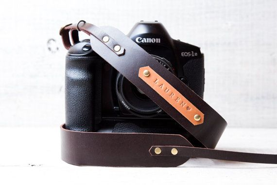 DSLR camera strap leather camera strap with personalization Canon camera strap Nikon camera strap DSLR straps  >>> Originally designed and hand made at viveo studio. Size: Maximum length when attached 115 cm (45.5 in). Mounting rings are included in package. Will carry : Any digital or film camera. DSLR (Canon, Nikon, Sony, Pentax etc) Rangefinder - ( Fuji, Leica, Canon, Nikon, Olympus ) Medium format cameras ( Hasselblad, Rolleiflex, Mamiya, Yashica, Pentax, Zenza Bronica).  Comes with…