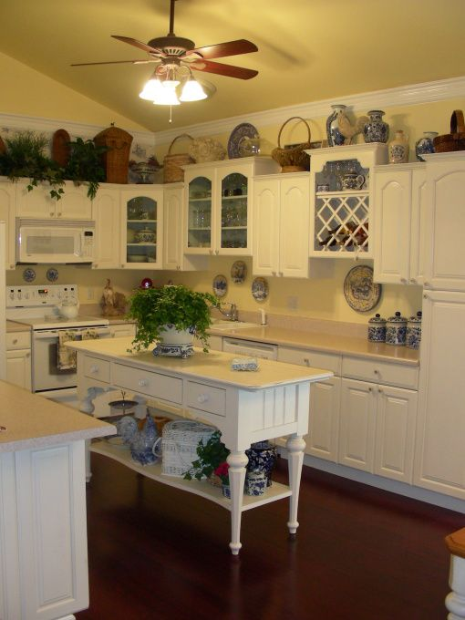French Country Kitchen, F.Y.I. the cabinets are a slightly off white color. They have a darker cream glaze rubbed into the crevices and a de...