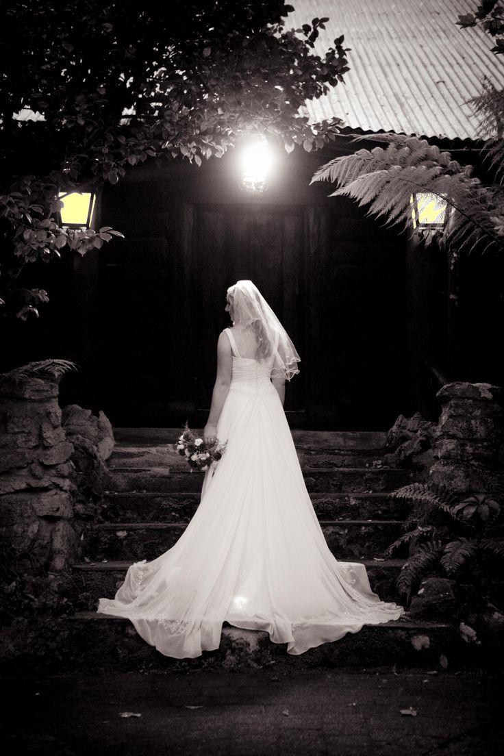 Bridal portrait outside the log cabin #chateauwyuna #wedding #bride #groom #mrandmrs #weddingreception #married #logcabin #long dress #overtheshoulder #bouquet #veil #photo #weddingshot