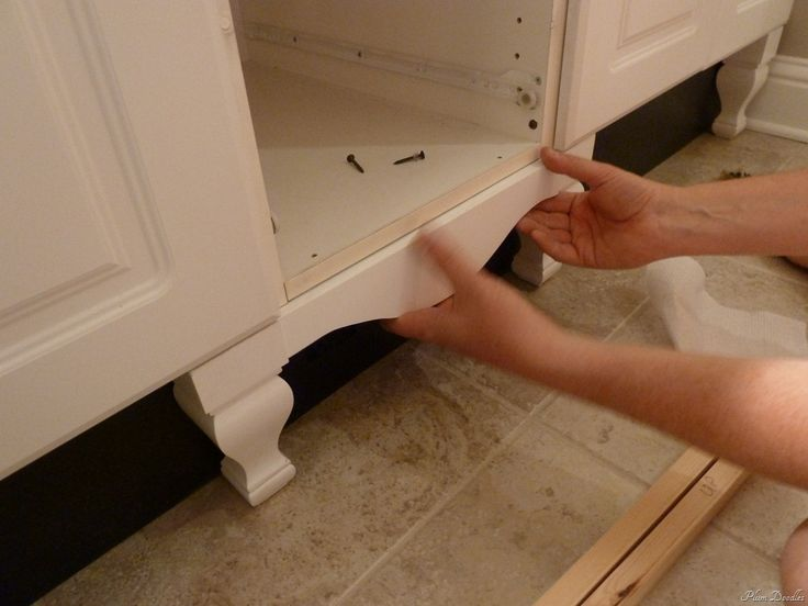 give a standard cabinet a custom look with legs and trim  (I did this in my kitchen - the legs - but now I want to add the trim, too!)