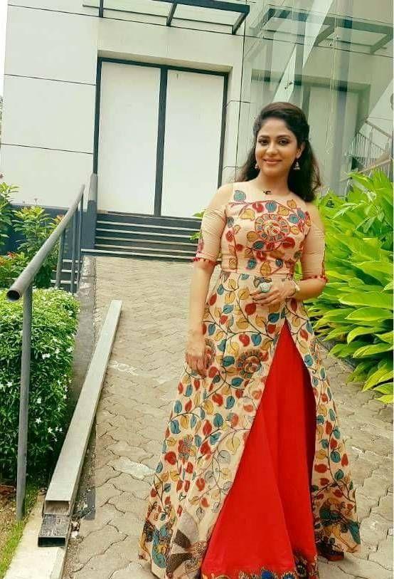 Poornima indrajith in hand painted kalamkari top paired with red kalamkari painted skirt. #pranaah