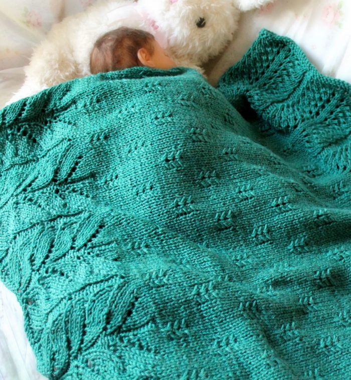 Knitting Pattern for Bee Tree Blanket - Two coordinating lace patterns form the deep borders on each end with a simple, elegant pattern for the middle section. 3 Sizes: Stroller: 33 x 36 in, Receiving: 40 x 42.5 in, Adult Throw: 53 x 60 in. Worsted weight yarn. Designed by Betty Fay Wallace