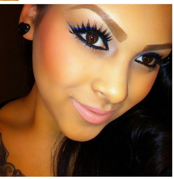 .love her falsies...but those painted on eyebrows have GOT ...