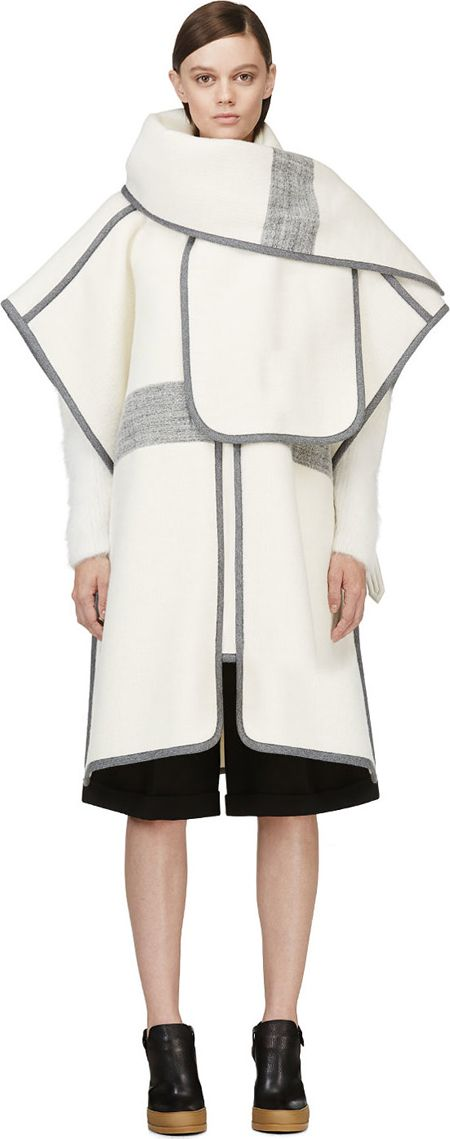 Unstructured wool poncho-style coat in ivory white. Knit trim and accent stripes throughout in grey. Self-tie scarf detail at collar. Open front. Open sides with tonal leather cinch belts. Designed by Chloe. http://zocko.it/LD4Kv
