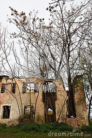 House in ruins on a field in north Italy, Veneto,