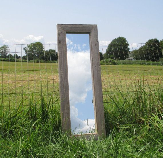 Rustic reclaimed wood floor mirror made from weathered reclaimed wood. Comes complete with hanging hardware attached. Measures 40 x 14.