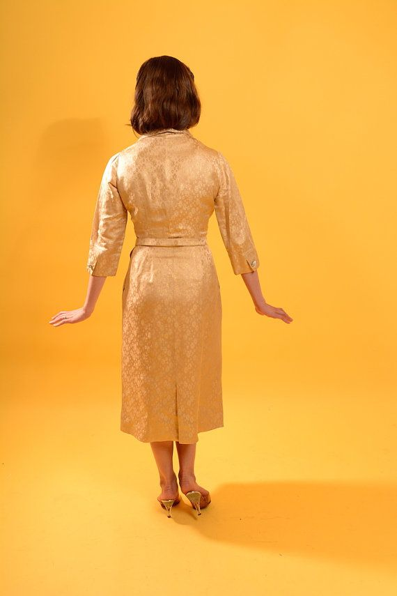 https://www.etsy.com/listing/241472359/1950s-gold-brocade-dress-with-flower?ref=related-7