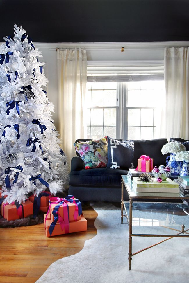 Add a whimsical feel to your home with this holiday decor inspiration featuring jewel-toned accessories and a pop of Midnight in NY black BEHR paint. This fun design is sure to showcase your personal style beautifully!