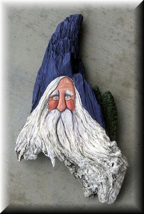 Painted Driftwood Santa.  Maybe I could do something similaar with the driftwood I picked up ... it is long and narrow, must give it some thought!!!