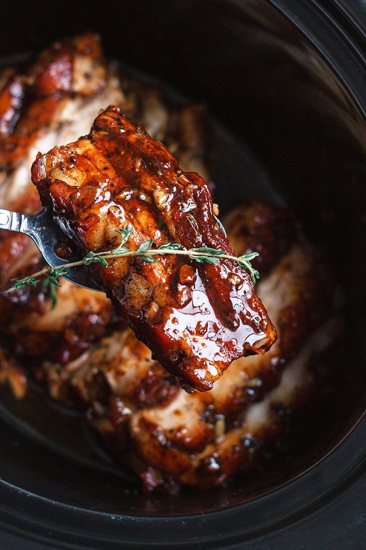 Slow Cooker Pork Belly with Honey Balsamic Glaze - Fall-apart tender and infused with a sticky tangy glaze.