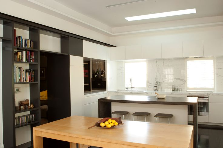 Kitchen and dining area open plan with view through to media room. Brooke Aitken Design.