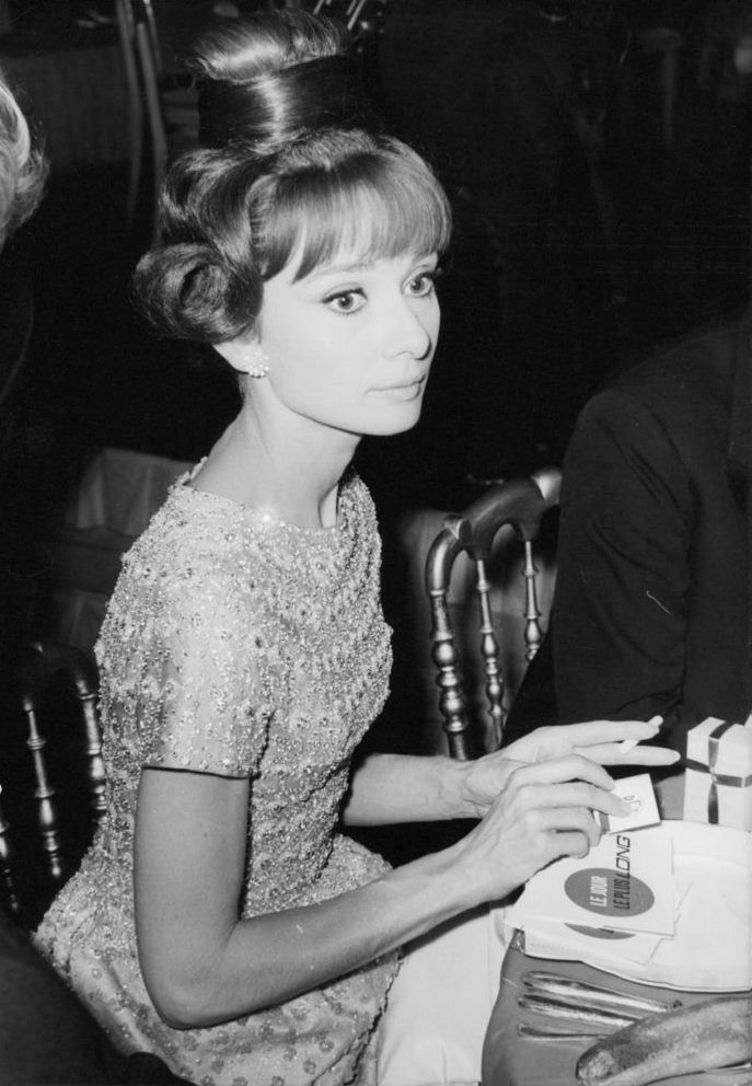 """The actress Audrey Hepburn photographed at the Palais de Chaillot, located at Place du Trocadéro et du 11 Novembre, in the 16e arrondissement of Paris (France), during a dinner offered after the French premiere of """"The Longest Day"""", on September 26,..."""