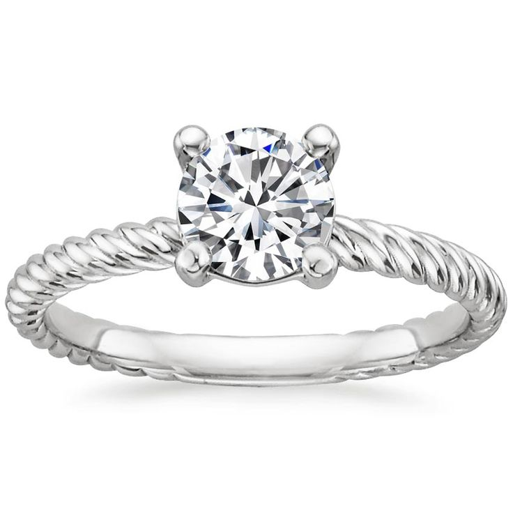 unique band on this diamond solitaire ring