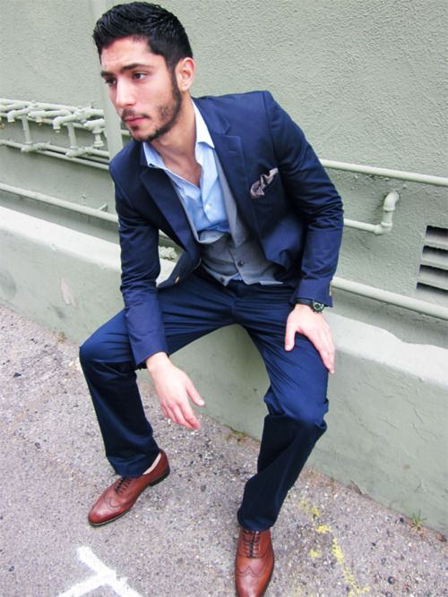 i love this grey vest with navy suit combo.