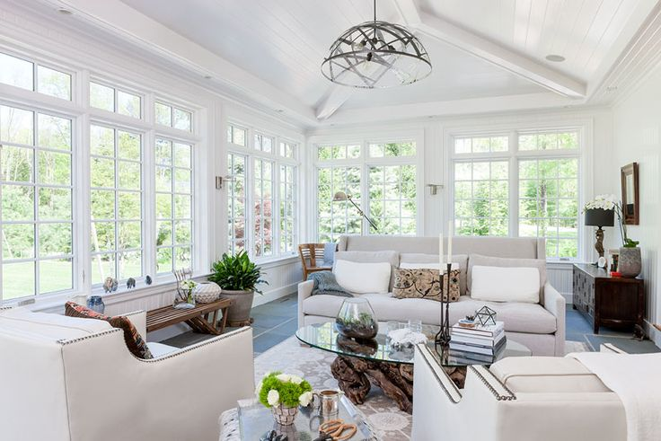 Sunroom features a vaulted ceiling, a bluestone floor with hydronic radiant heat, and tall casement windows with transoms above.