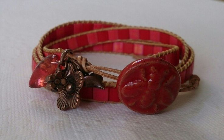 Triple wrap bracelet with a ceramic button by Bo Hulley Beads.