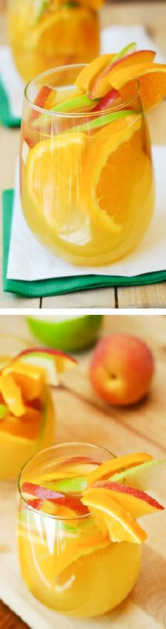 Addictive White Sangria, with peaches, green and red apples, oranges! A light and fruity drink. JuliasAlbum.com #cocktails #partyfood