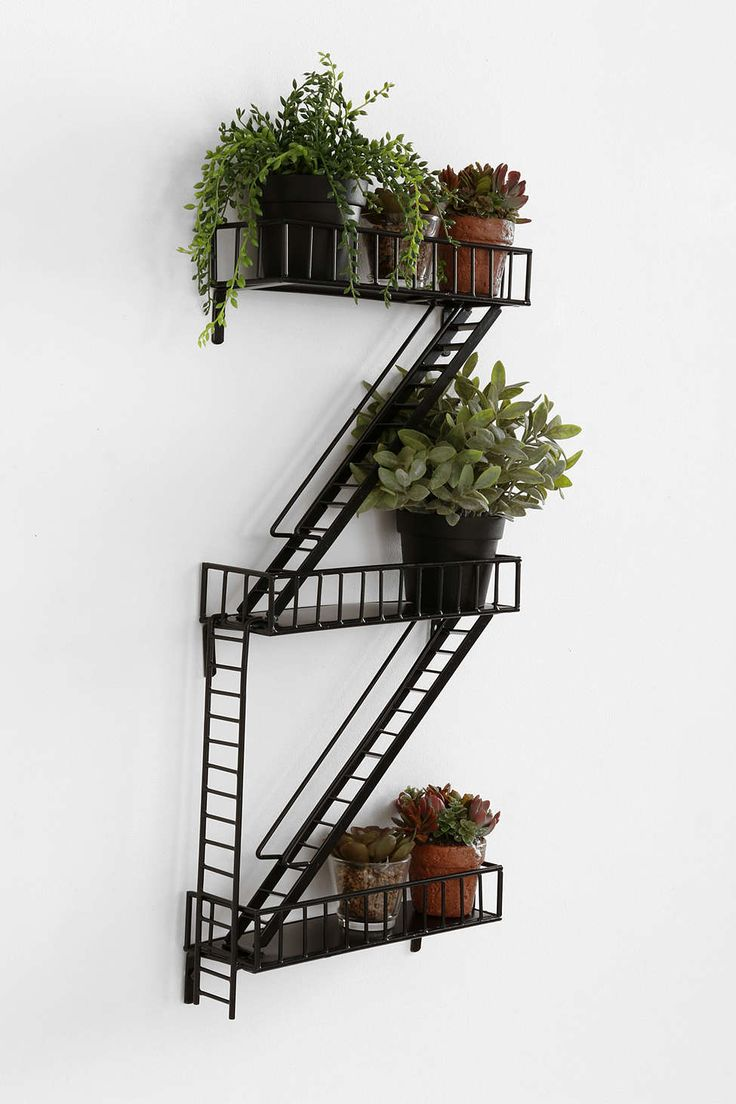 Prepare to outdo all the other guests with this fun and functional gift. | Urban Outfitters Fire Escape Wall Shelf. Click here to see this and other great gifts.