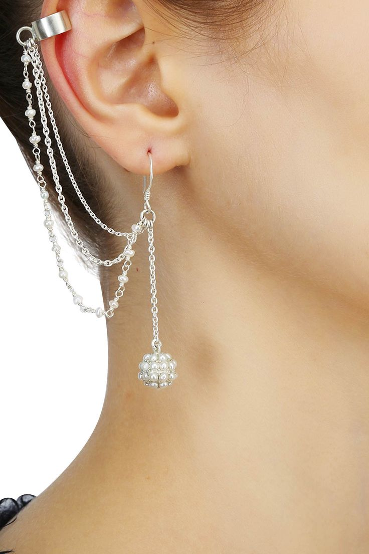 Silver finish seed pearl earrings with attached chain earcuffsavailable only at Pernia's Pop Up Shop.