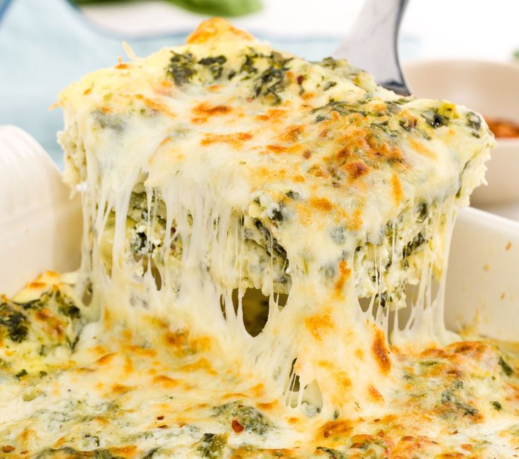 Chicken spinach artichoke lasagna. Sub heavy cream for milk, gluccie for flour, and zucchini for noodles
