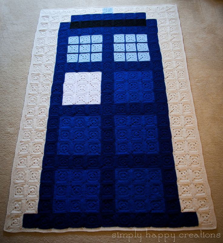 """Tardis - Doctor Who Crochet 8-Bit Pixel Afghan ( 260 solid granny squares are crocheted together with a 1-inch off-white border around the edge. It measures approximately 86"""" long and 56"""" wide) by simplyhappycreations"""