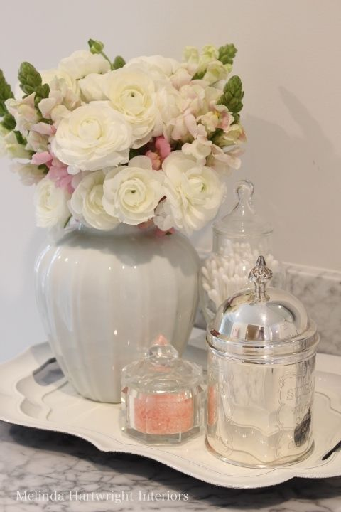 Pink and white bathroom accessories                                                                                                                                                     More
