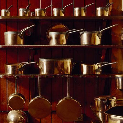 Brass saucepans displayed in the Kitchen at Cragside