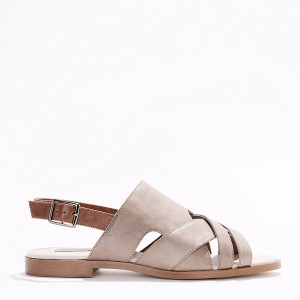 A two-tone full leather sandal. An adjustable contrast leather strap around the back ankle, extra padding at insole and a resin outsole for longer wear.