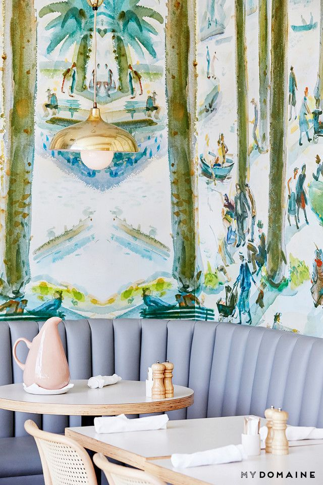 The true Instagrammable moment of the restaurant comes with the dining room décor, which mixes brass pendant with Josef Hoffmann cane chairs, blue-gray banquettes, and showstopping...