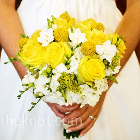 Britta's eye-catching yellow-and-white bouquet was filled with roses, freesia, craspedia and hydrangeas.