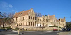 The building was built using convict labour between 1861 and 1868 and was used as a psychiatric hospital, initially called the Fremantle Lunatic Asylum, and later known as the Asylum for the Criminally Insane. It is located opposite the Fremantle Leisure and Aquatic Centre and also near two schools: John Curtin College of the Arts (formerly Fremantle Boys School) and CBC Fremantle.