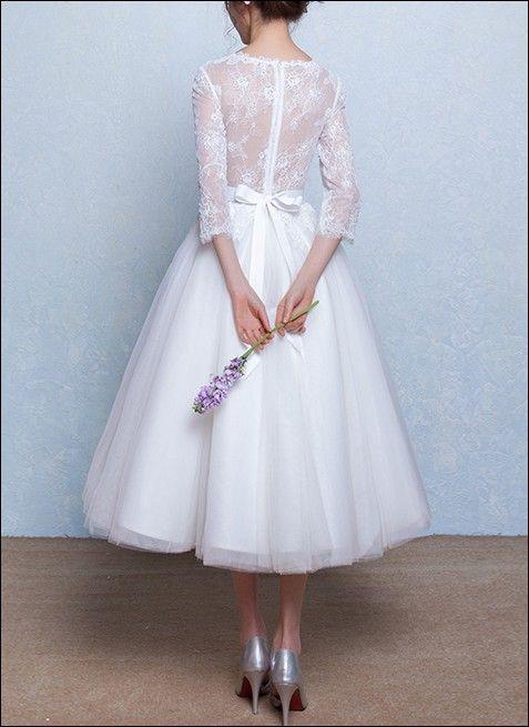 50er Jahre Vintage Brautkleid mit langen Ärmeln. A-Linie Rock Wadenlang geschnitten.