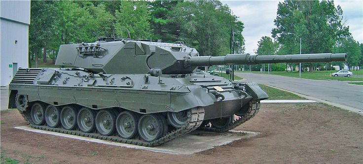 German Leopard 1 (introduced 1965) -- 105 mm cannon -- 2x 7.62 mm machine guns -- 46.52 tons (produced in variants 1A1 to 1A6 with various technology/design upgrades)