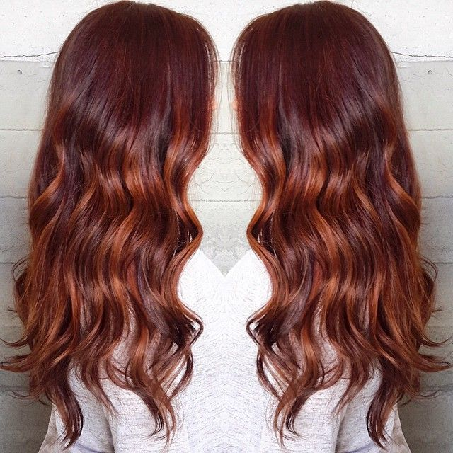 Red lava color melt ombre on this beauty with long hair by Masey at Butterfly Loft salon in Encino, Los Angeles. #haircolor #hairstyle #hairinspiration