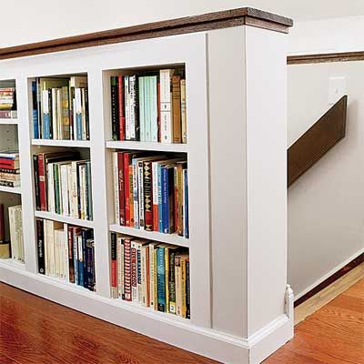 Storage: Delineate Space With It    Look for ways to work storage into the room's interior. Here, a half-wall along a staircase doubles as a bookshelf next to a home office. Might work in the loft...