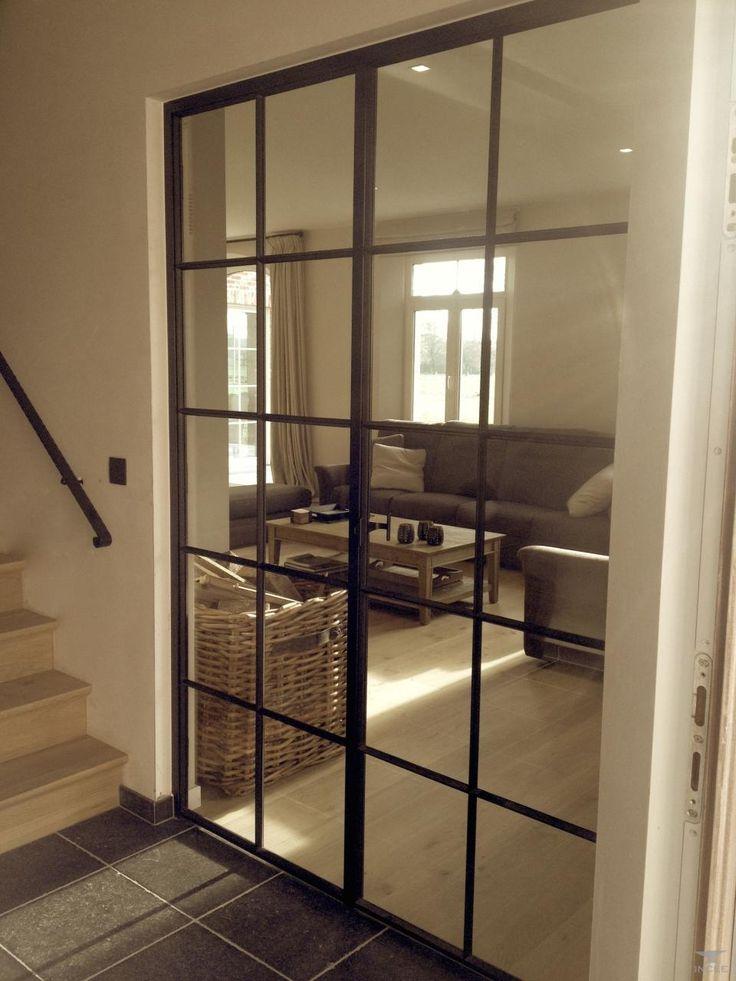 Woonkamer - smeedijzeren dubbele deur, maar zou natuurlijk ook in aluminium…