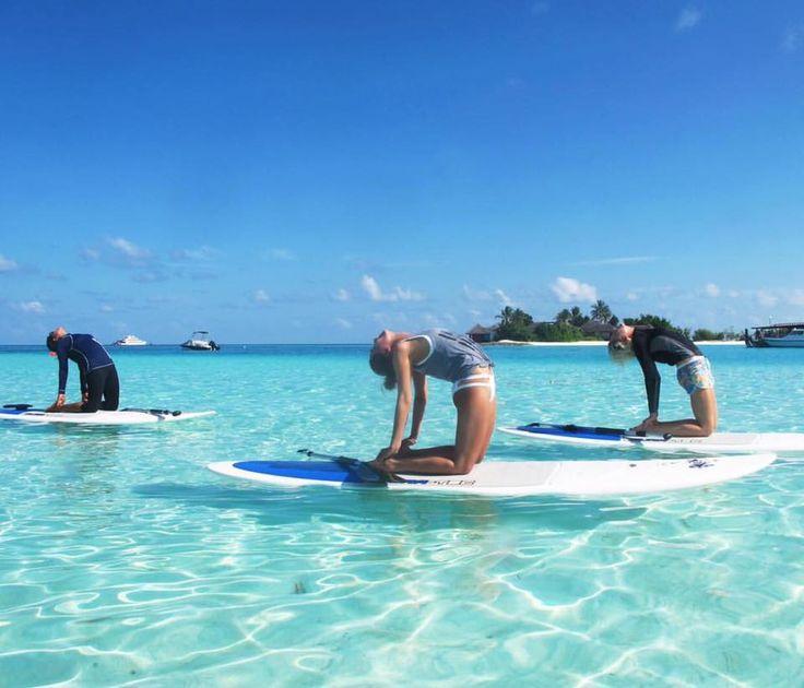 SUP (Stand Up Paddleboard) yoga at Four Seasons Kuda Huraa Maldives