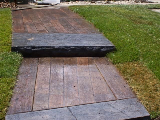 Wood Plank Sidewalk Stamped Concrete Or Deck Boards With A 6x6 At The Step