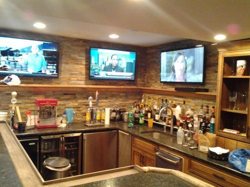 Multiple Flat Panel Tv S Mounted On Brick Wall Of Home
