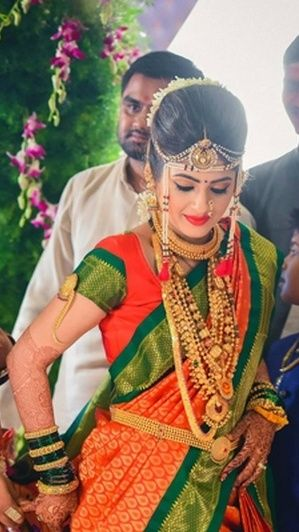 Vibrant Orange and Green Nauvari Saree with Traditional Gold Jewelry on a Beautiful Marathi Bride