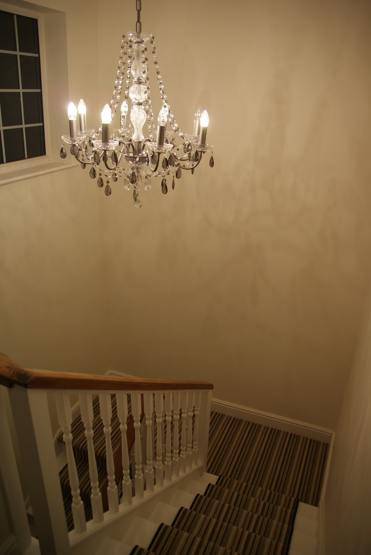 Striped stair runner and grey glass chandelier