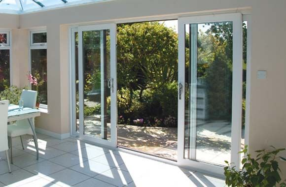 Cool sliding glass doors that are large enough to create a big space