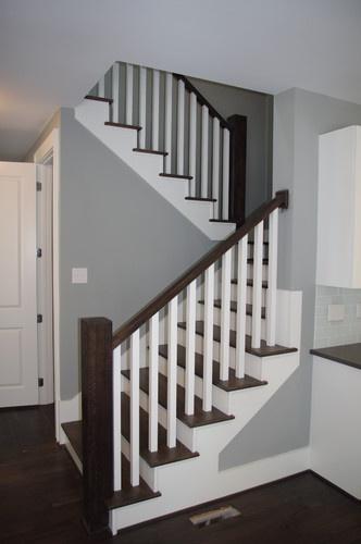 Stairs   2 White Spindles On Each Dark Wood Tread. Dark Wood Railing. White